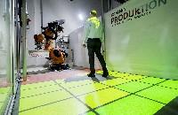 Dynamische Schutzfelder für sichere Zusammenarbeit von Mensch und Roboter